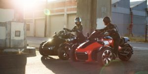 A couple in an urban area both riding Can-Am Spyders
